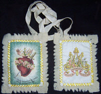 The Scapular of the Immaculate Heart of Mary was sanctioned and endowed with indulgences by Pius IX in 1877, and further indulgences were granted for its use under Pius X in 1907. It is the special badge of the religious congregation known as the Sons of the Immaculate Heart of Mary. It is of white woolen cloth, one part being ornamented with a picture of the burning heart of Mary, out of which grows a lily; the heart is encircled by a wreath of roses and pierced by a sword.